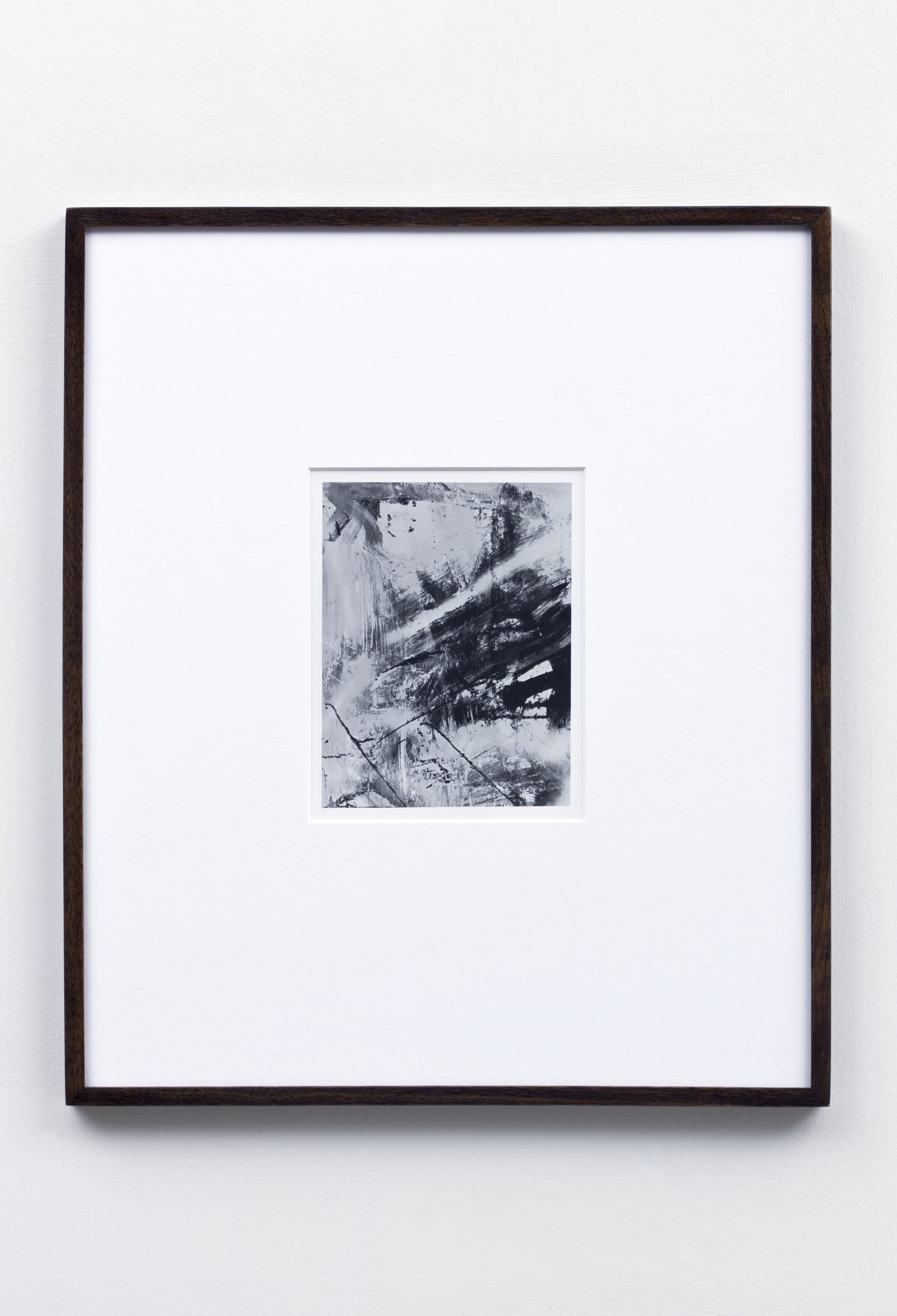 a black and white photograph by anthony pearson that's part of a larger installation