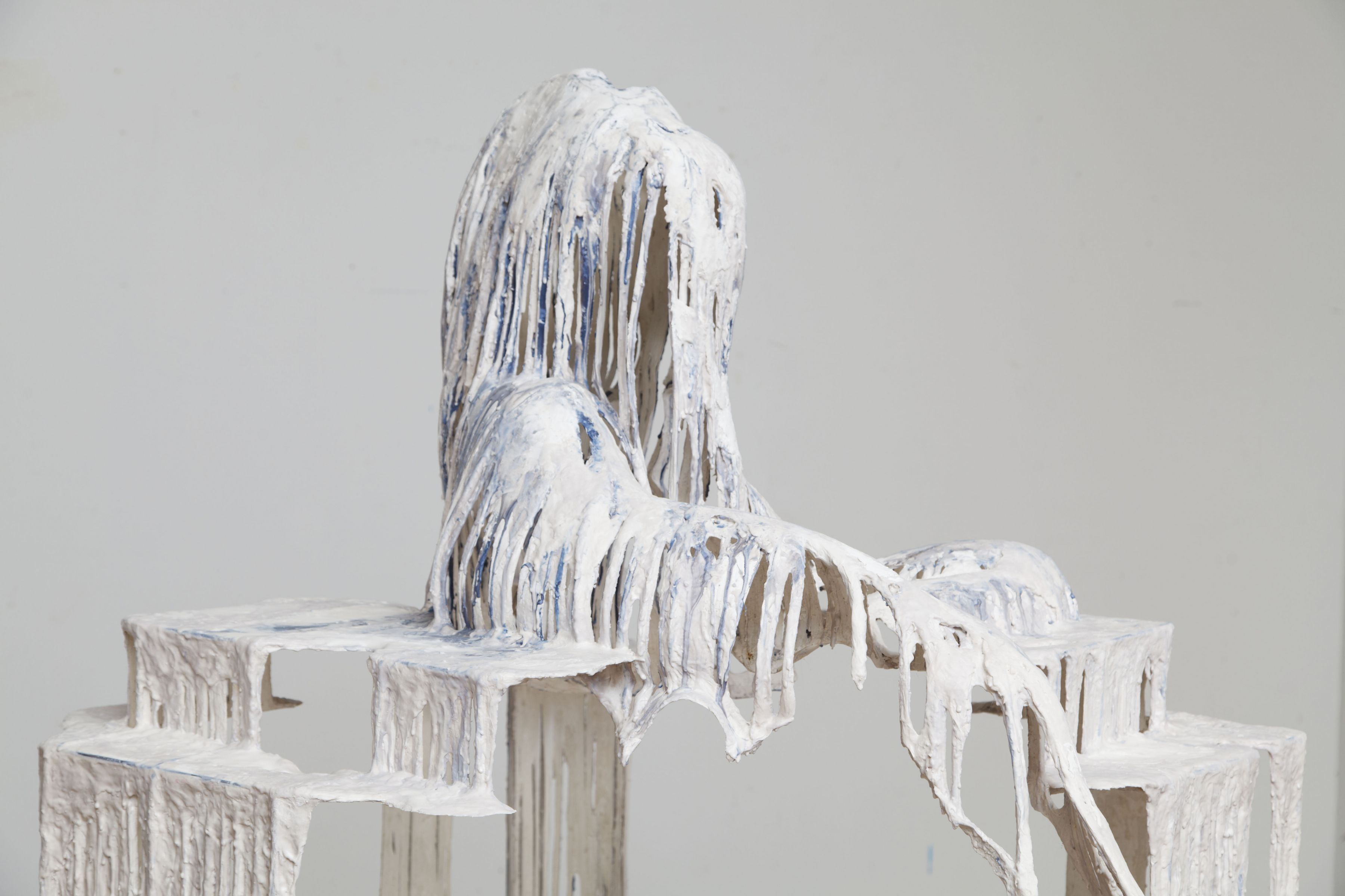 a detail of a white drip sculpture by the artist Diana Al-Hadid available for purchase