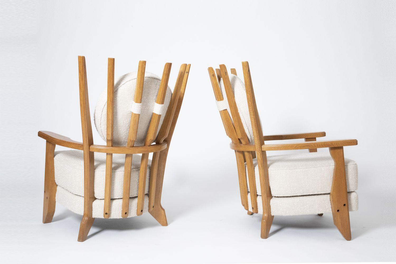 """Guillerme et Chambron's Pair of """"Tapissier"""" armchairs, full diagonal back view and side view of both armchairs"""
