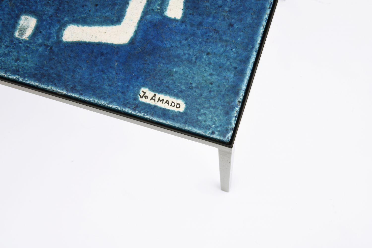 Jo Amado's ceramic coffee table, detailed view of ceramic top showing signature