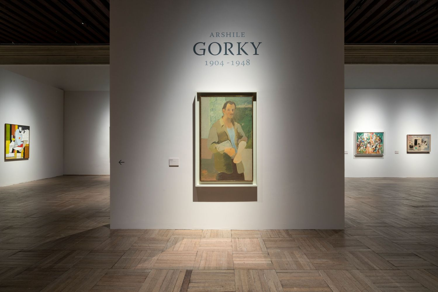 Installation photograph showing a self-portrait painting by Gorky