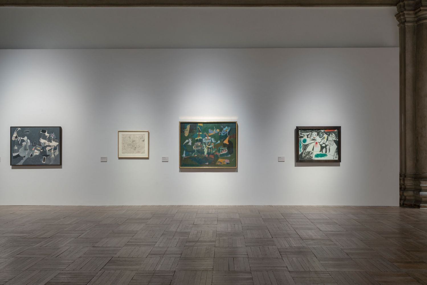 Installation photograph showing four works by Gorky: Soft Night, a preparatory drawing for Dark Green Painting, Dark Green Painting, and Last Painting