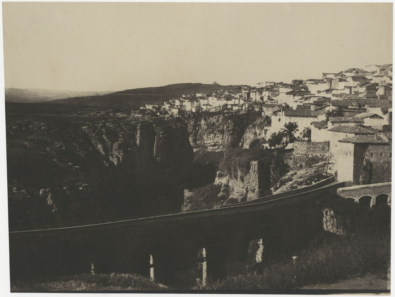 "John Beasley GREENE (American, born in France, 1832-1856) El-Kantara Bridge, Constantine, Algeria*, 1855-1856 Lightly coated salt print from a paper negative 22.5 x 30.3 cm on 22.8 x 30.3 cm paper Inscribed ""Constantine"" in pencil on verso"