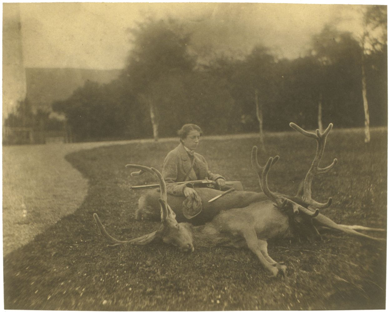 """Captain Horatio ROSS (Scottish, 1801-1886) """"Ned & his two Stags. Killed right & left in Corne Valigan..."""", July 1857 Salt print from a collodion negative 18.7 x 23.3 cm mounted on 26.0 x 33.5 cm album page Titled and dated in pencil on mount"""