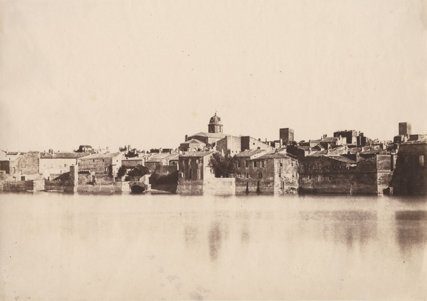 """Charles NÈGRE (French, 1820-1880) View from the banks of the Rhône """"Arles"""", 1852 Salt print from a waxed paper negative 22.9 x 32.5 cm Inscribed """"E-16"""" and """"No 86"""" in pencil on verso"""
