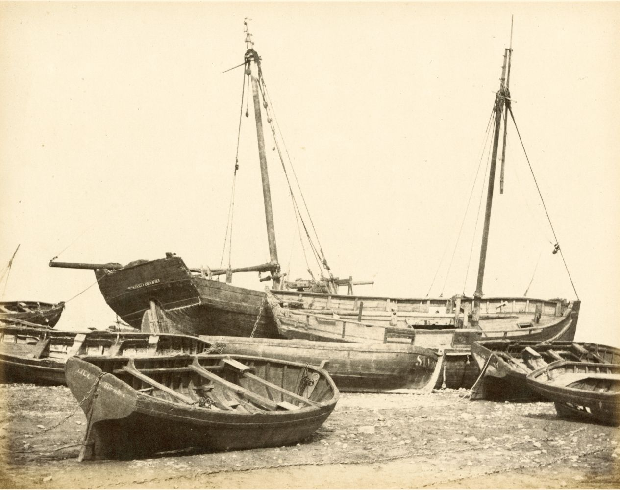 """Hugh OWEN (English, 1808-1897) Oyster boats, Swansea Albumen print, 1860s-1870s, from a paper negative, before 1855 17.3 x 22.2 cm mounted on 26.0 x 28.3 cm album sheet Numbered """"60"""" in pencil on mount"""