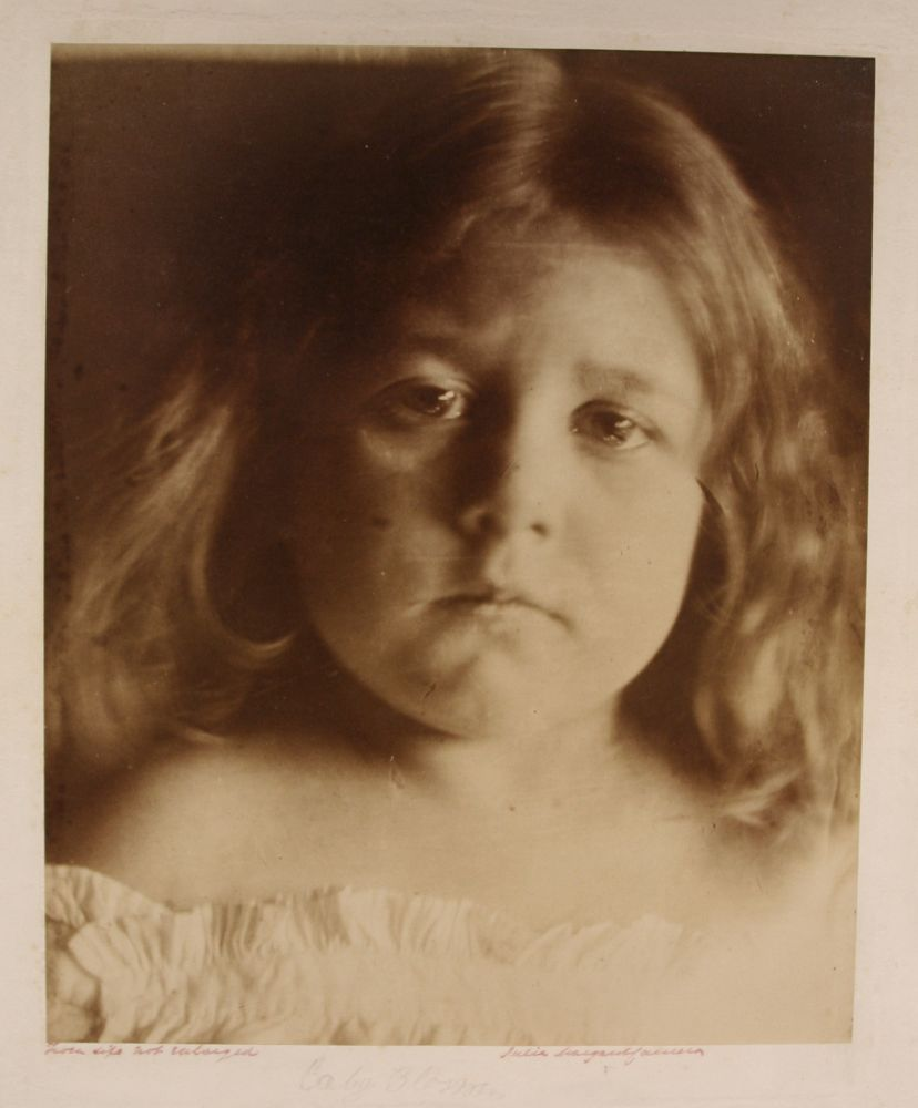 "Julia Margaret CAMERON (English, born in India, 1815-1879) ""Baby Blossom"" Alice Keown, circa 1866 Albumen print from a wet collodion negative 34.1 x 27.8 cm mounted on 52.3 x 45.4 cm card Signed, inscribed ""From life not enlarged"" in ink, titled in an unknown hand in pencil, with Colnaghi blindstamp on moun"