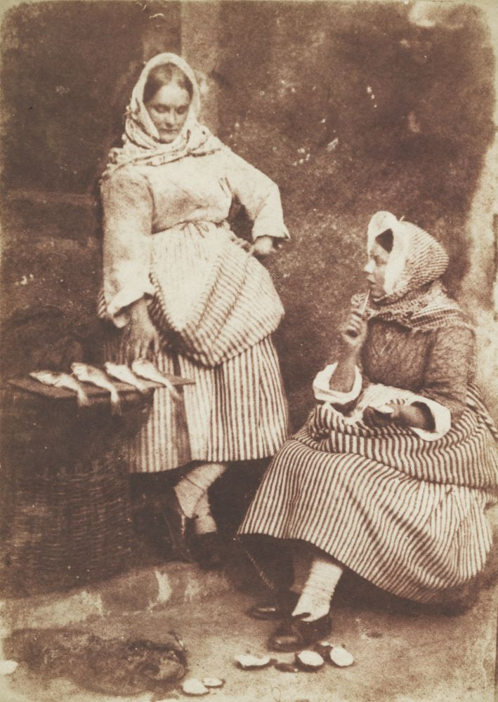 "David Octavius HILL & Robert ADAMSON (Scottish, 1802-1870 & 1821-1848) Jeanie Wilson and Annie Linton, Newhaven, ""They were twa bonnie lasses"", circa 1845 Salt print from a calotype negative 19.0 x 13.6 cm mounted on 37.4 x 26.2 cm grey paper ""58"" noted in pencil on mount verso"