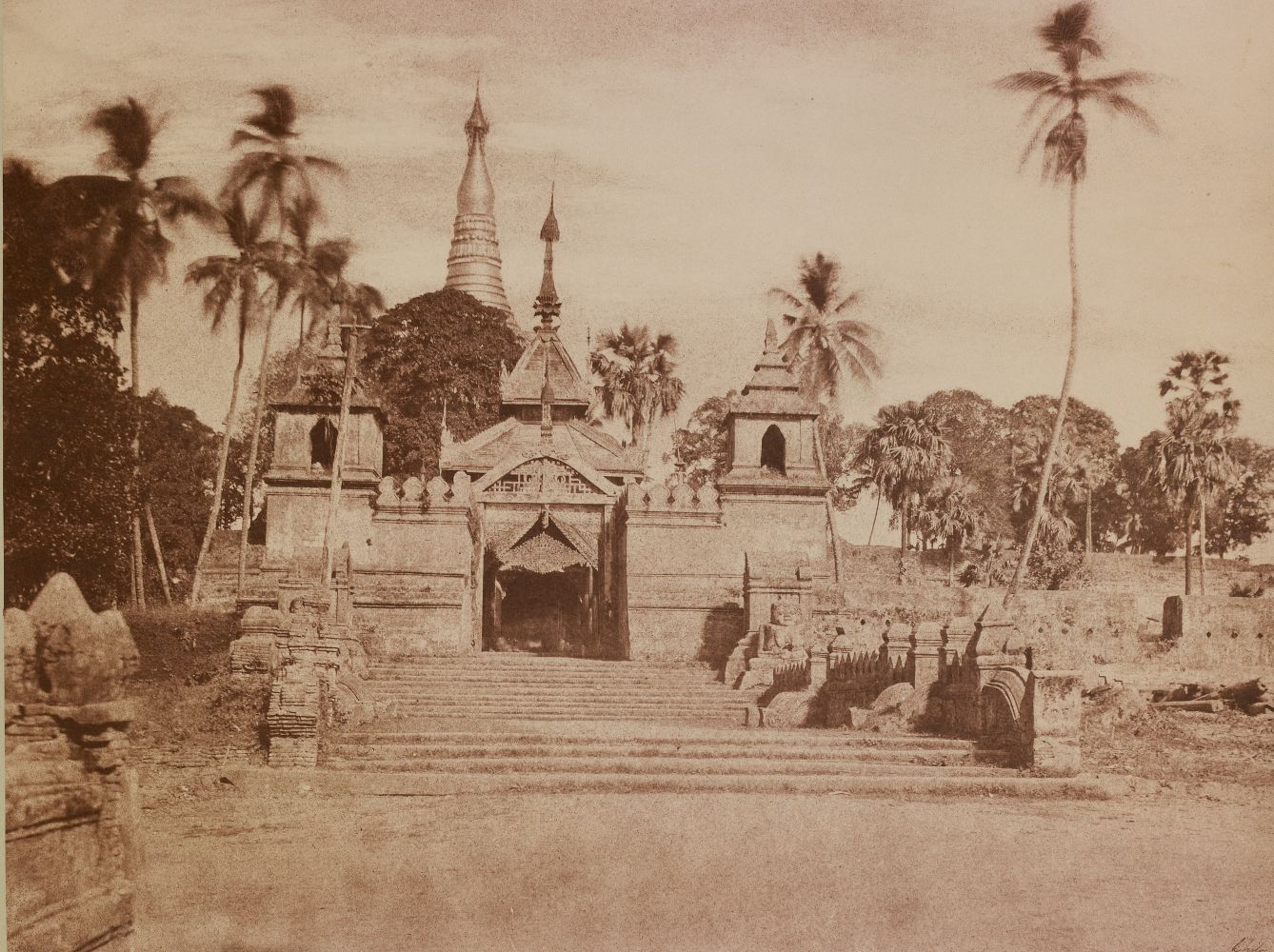 "Captain Linnaeus TRIPE (English, 1822-1902) ""No. 108. Rangoon. South Entrance of Shwe Dagon Pagoda."" Burma, 1855 Albumenized salt print from a waxed paper negative 25.9 x 34.3 cm mounted on 45.6 x 58.4 cm paper Signed ""L. Tripe"" in ink. Photographer's blindstamp and printed label with plate number, title and ""The road which leads to this, is, on festival days, crowded with Burmese men, women, and children, in gay silks and muslins carrying offerings to the Pagoda."" on mount."