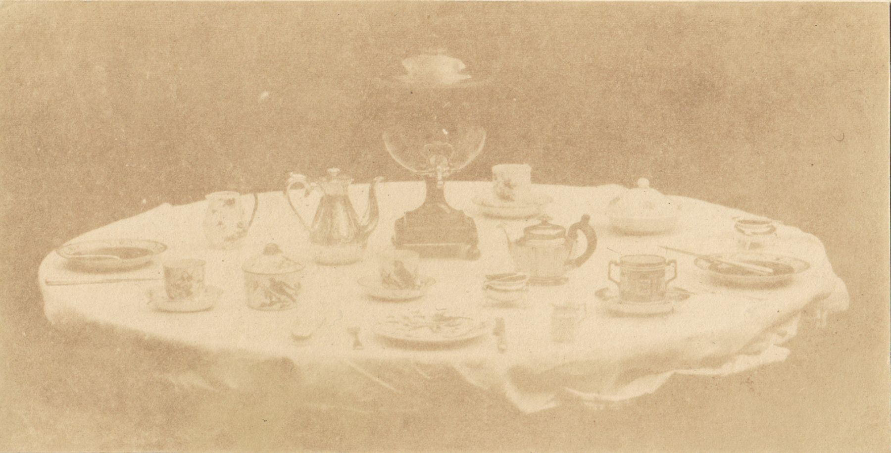 "William Henry Fox TALBOT (English, 1800-1877) Table set for tea, 1841-1842 Varnished salt print from a calotype negative 8.5 x 16.8 cm mounted on card, ruled  ""Patent Talbotype Photogenic Drawing"" label on mount verso"