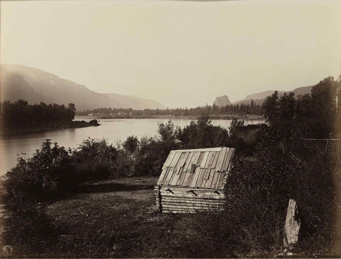 """Carleton E. WATKINS (American, 1829-1916) The Garrison, Columbia River, Oregon, circa 1867 Mammoth plate albumen print 40.3 x 52.7 cm mounted on 53.0 x 67.0 cm board Titled in an unidentified contemporary calligraphic hand in ink and numbered """"23"""" in an unidentified modern hand in pencil on mount. Two San Francisco Museum of Modern Art exhibition labels on verso."""