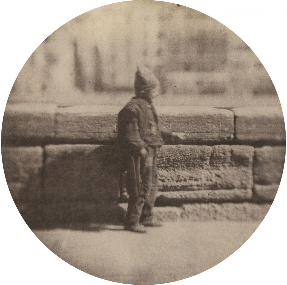 "Charles NÈGRE (French, 1820-1880) Le petit ramoneur, December 1851 Salt print from a waxed paper negative with selectively applied graphite 8.7 cm tondo Blindstamp ""Canson"""