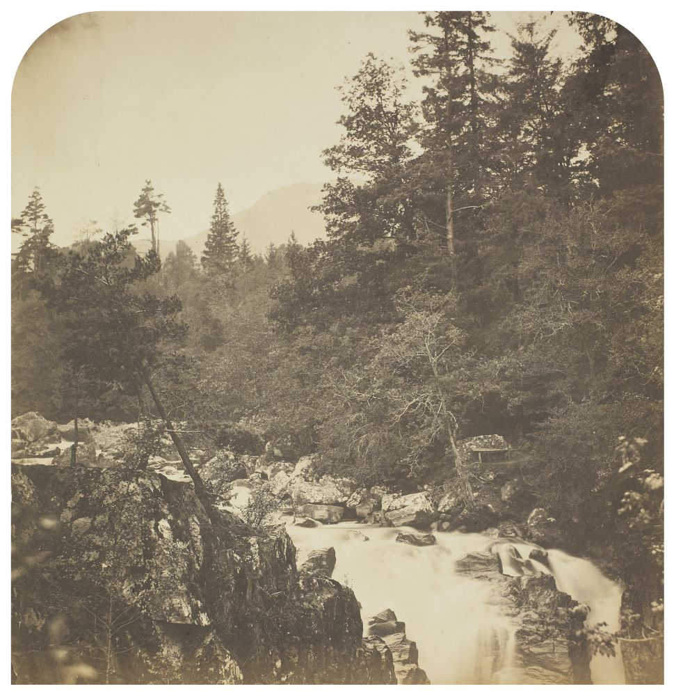 Roger FENTON (English, 1819-1869) Landscape with waterfall, 1850s Salt print from a collodion negative 31.5 x 30.6 cm, top corners rounded