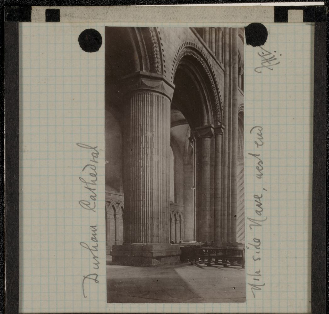 """Frederick H. EVANS (English, 1853-1943) """"Durham Cathedral, Nth side Nave, west end"""", 1890s Lantern slide 7.0 x 3.6 cm on 8.2 x 8.2 cm glass slide Initialed """"F. H. E"""" and titled in ink on the paper mask"""