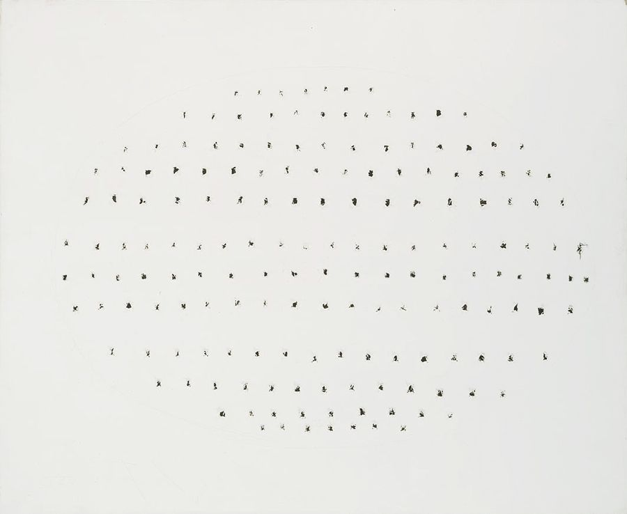 white canvas with perforations forming an oval shape