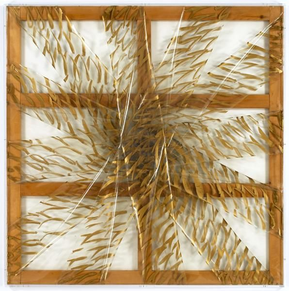 strips of transparent plastic with painted gold brush marks and stretched over a wooden frame to form asterisk shape