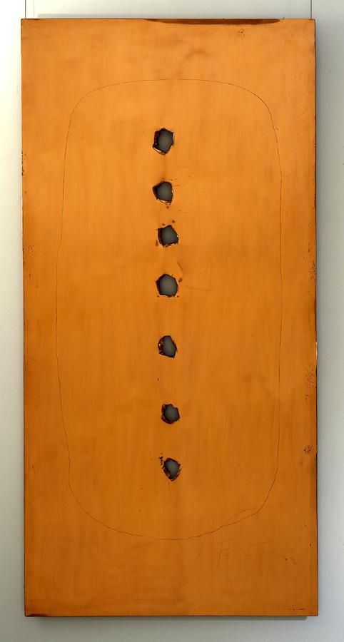 vertical copper composition with seven perforations in a vertical line