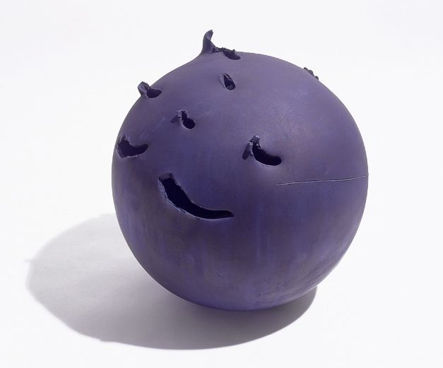 spherical purple ceramic sculpture with irregular perforations
