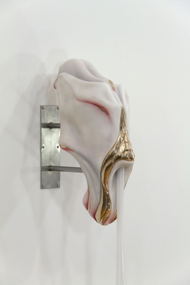 Side view of white angular sculpture by Ivana Bašić with bronze details and blown glass drips reminiscent of skin and flesh.