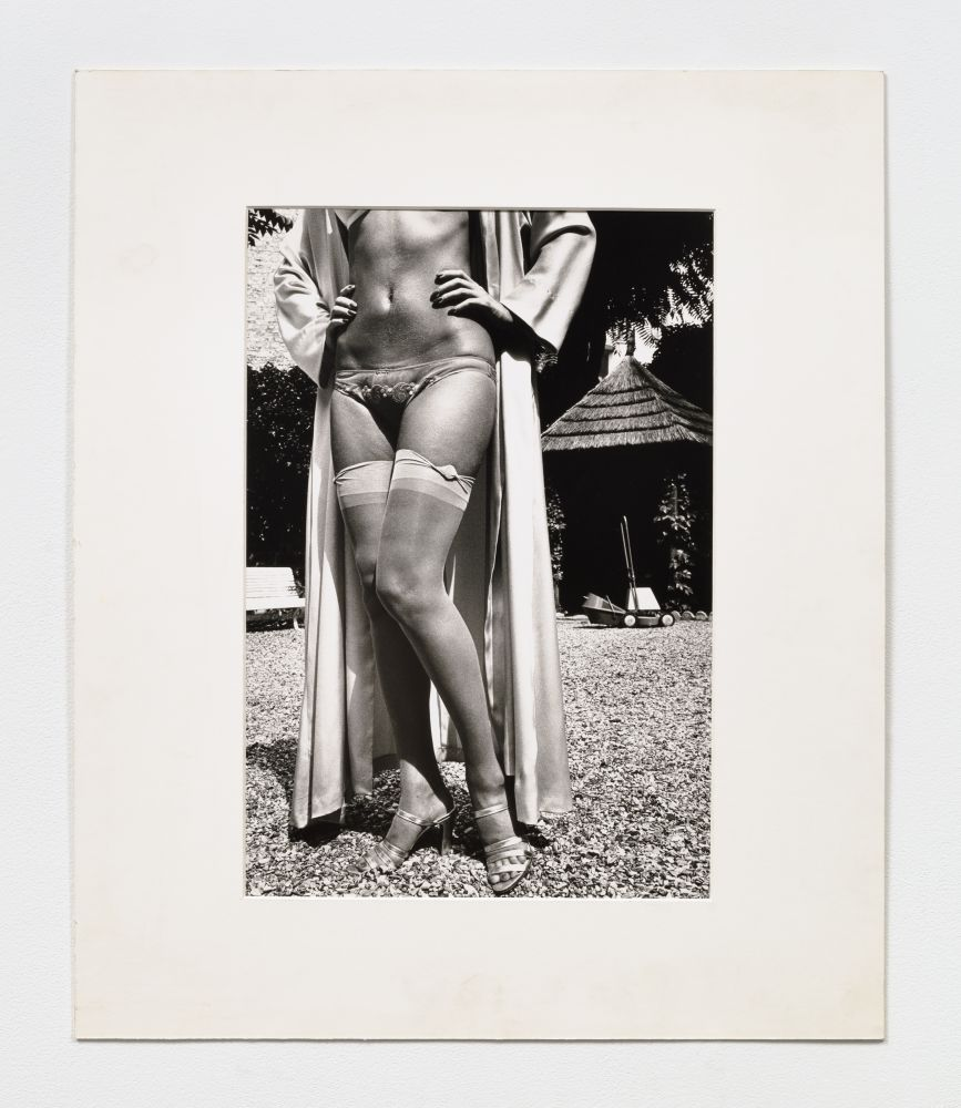Black and white photographic print by Helmut Newton of a woman's legs wearing stockings