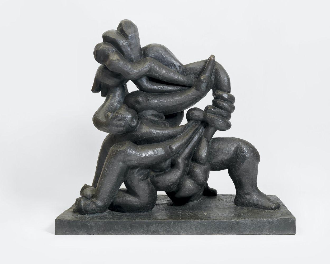 Bronze sculpture with contorted figures.