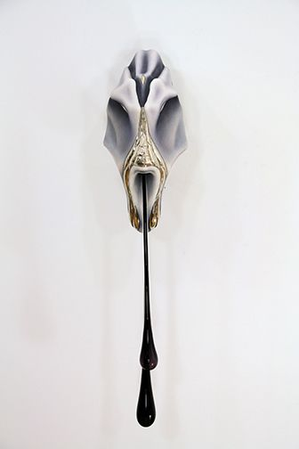 Frontal view of angular sculpture by Ivana Bašić with bronze details and and black blown glass drips reminiscent of skin and flesh.