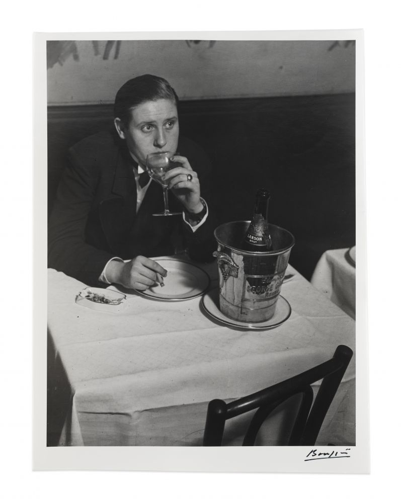 Black and white photographic portrait of woman dressed as a man at Le Monocle, Paris.