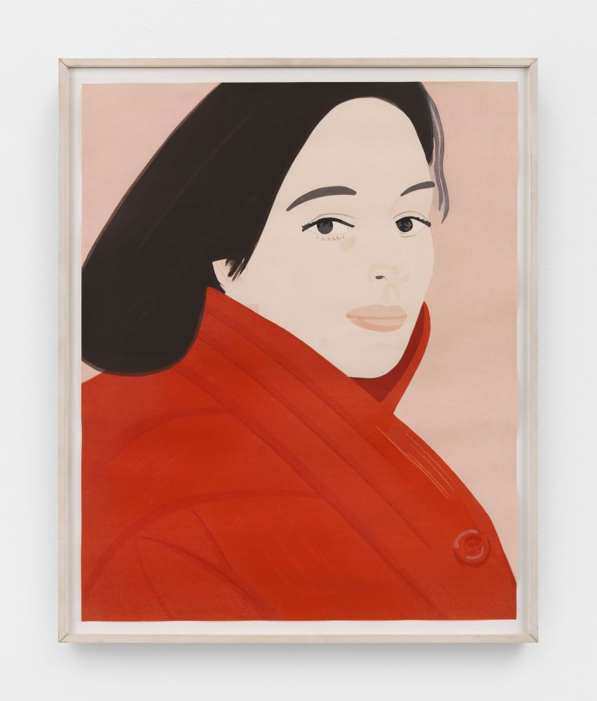 Framed color silkscreen of a woman with black hair and wearing a red jacket featuring her button against a pink background