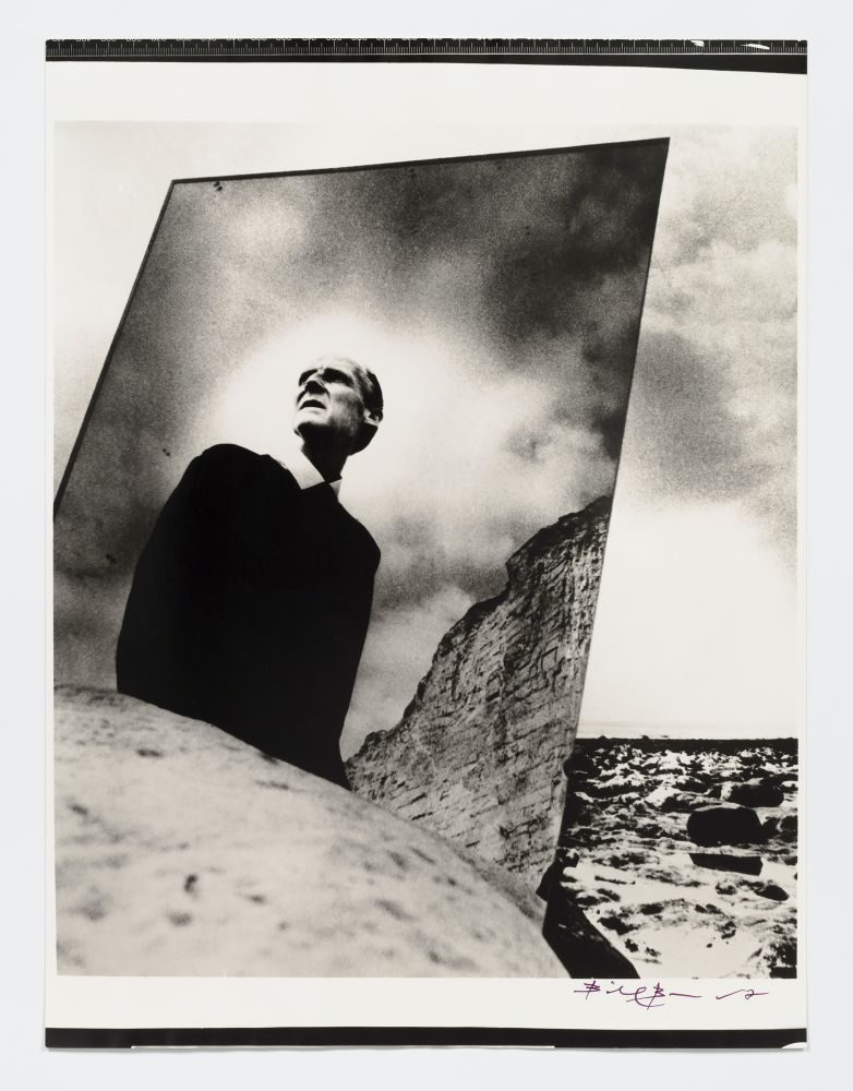 Black and white photographic portrait of Bill Brandt with mirror in nature