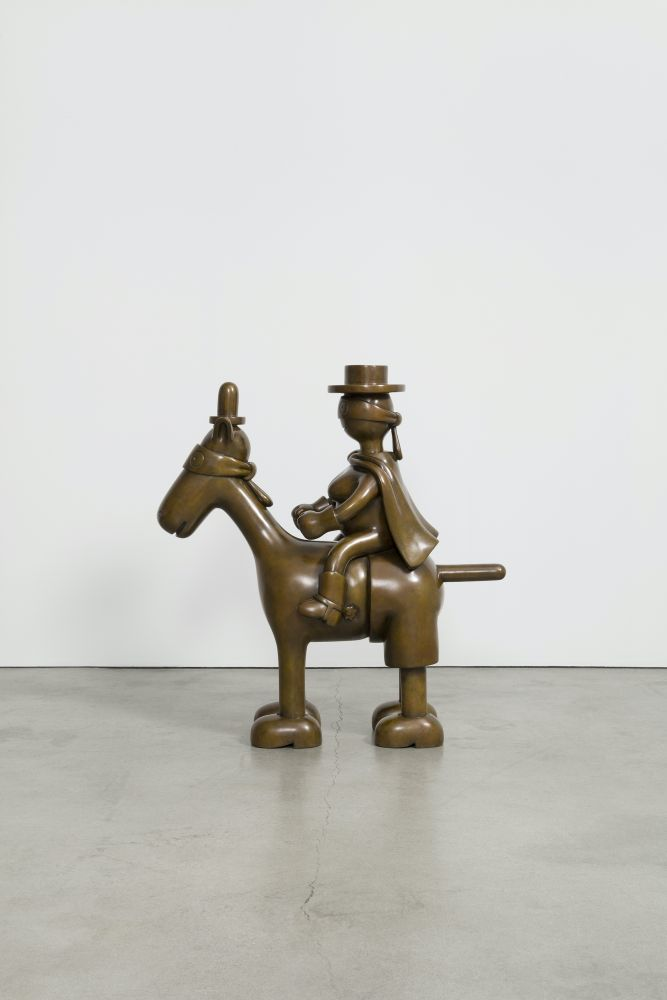 Bronze sculpture of a blindfolded horse and rider by Tom Otterness.