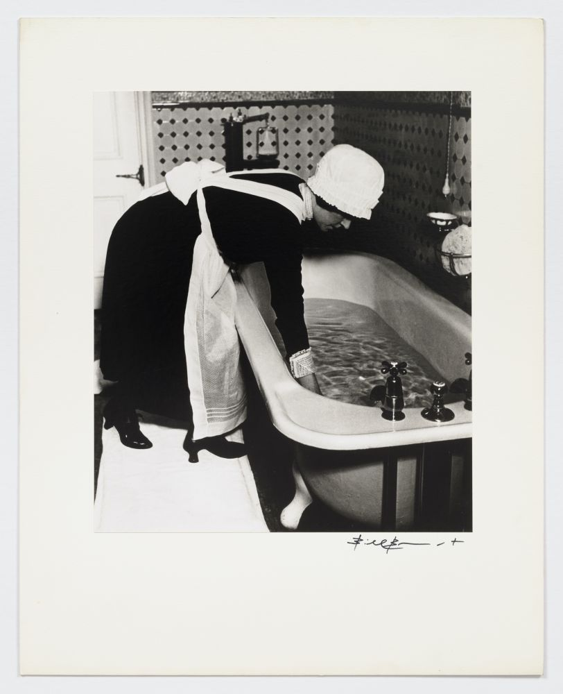 Black and white photographic portrait of parlormaid preparing a bath from the 1930s by Bill Brandt.