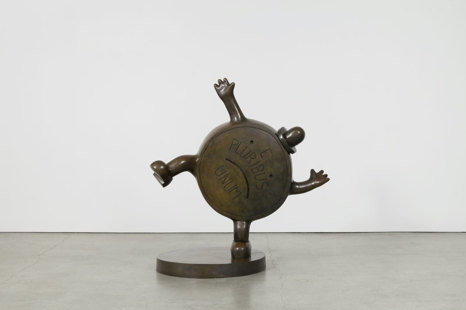 Bronze sculpture of a personified penny coin with top hat by Tom Otterness.