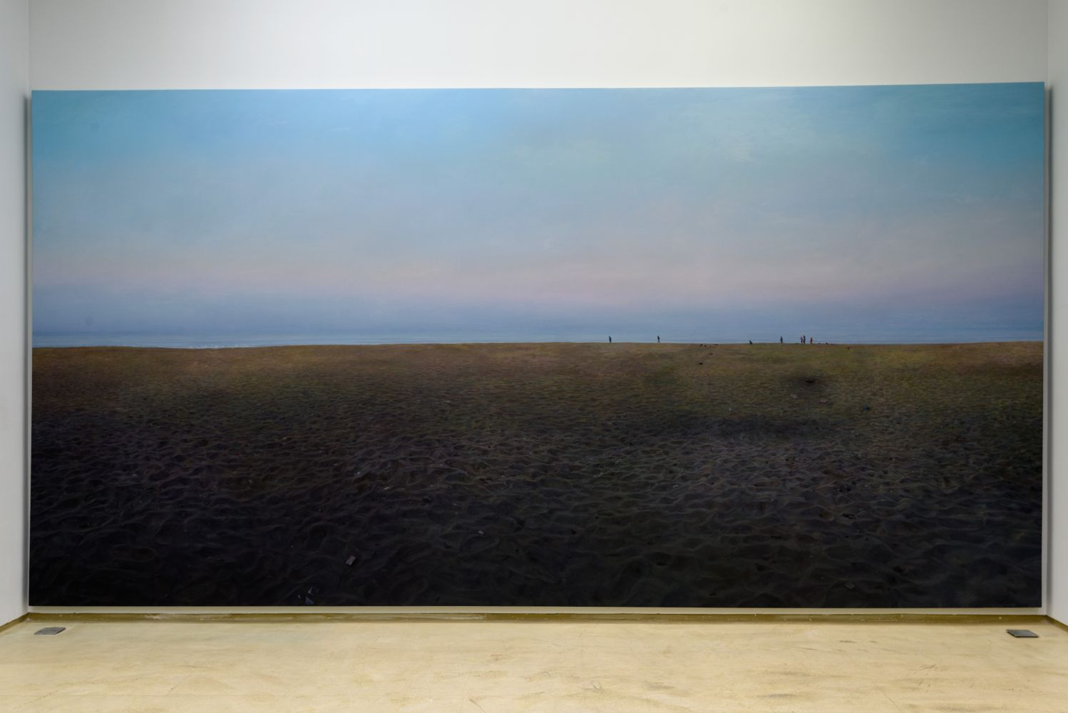ABIR KARMAKAR Abandonment of all that is Rational : Daybreak, 2017  Oil on canvas, vast landscape, few people in a distance, blue sky with pinkish hue