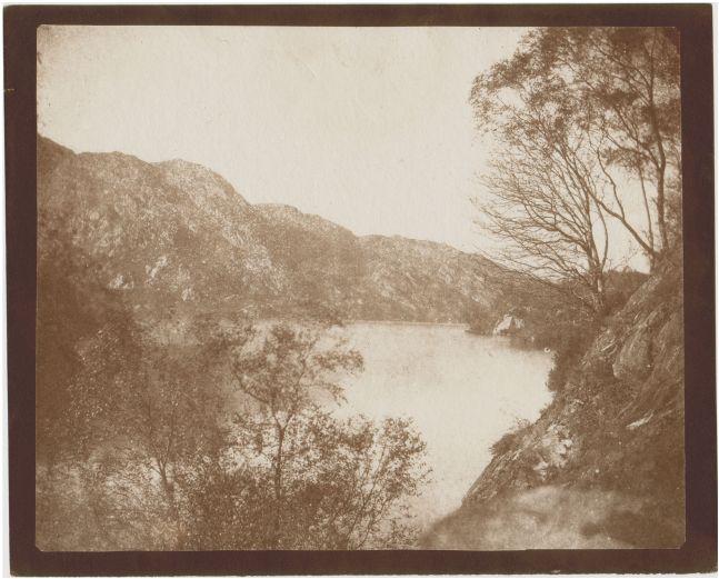 "William Henry Fox TALBOT (English, 1800-1877) Loch Katrine, 1844 Salt print from a calotype negative 17.0 x 20.9 cm on 18.6 x 22.9 cm paper ""LA36"" in black ink on verso"