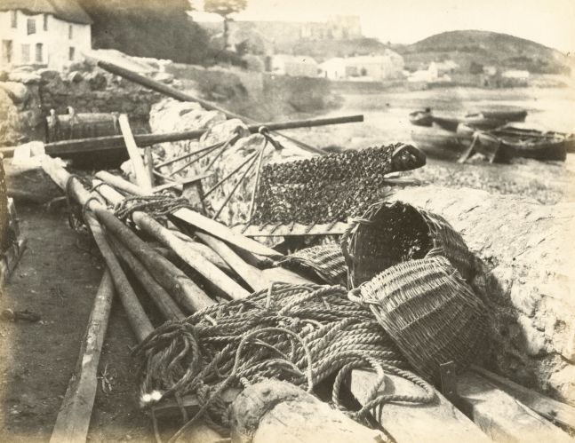 """Hugh OWEN (English, 1808-1897) Dredges and baskets at Oystermouth, The Gower Albumen print, 1860s-1870s, from a paper negative, before 1855 17.3 x 22.4 cm mounted on 26.0 x 28.3 cm album sheet Numbered """"71"""" in pencil on mount"""