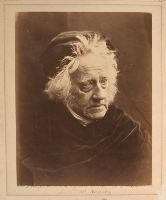 "Julia Margaret CAMERON (English, born in India, 1815-1879) Sir J. F. W. Herschel, 1867 Albumen print from a collodion negative 33.4 x 26.1 cm mounted on 46.9 x 40.4 cm paper Signed, titled and inscribed ""From Life taken at his own residence. Collingwood April 1867"" in ink on mount recto"