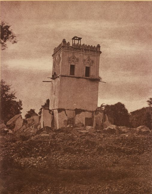 "Captain Linnaeus TRIPE (English, 1822-1902) ""No. 37. Ava. Tower of the Palace."" Burma, 1855 Albumenized salt print from a waxed paper negative 33.7 x 26.6 cm mounted on 58.4 x 45.7 cm paper Signed ""L. Tripe"" in ink. Photographer's blindstamp and printed label with plate number, title and ""This is the only co-herent remains of the palace. The earthquake of 1839 covered the ground with the rest of it and tilted this considerably."" on mount."