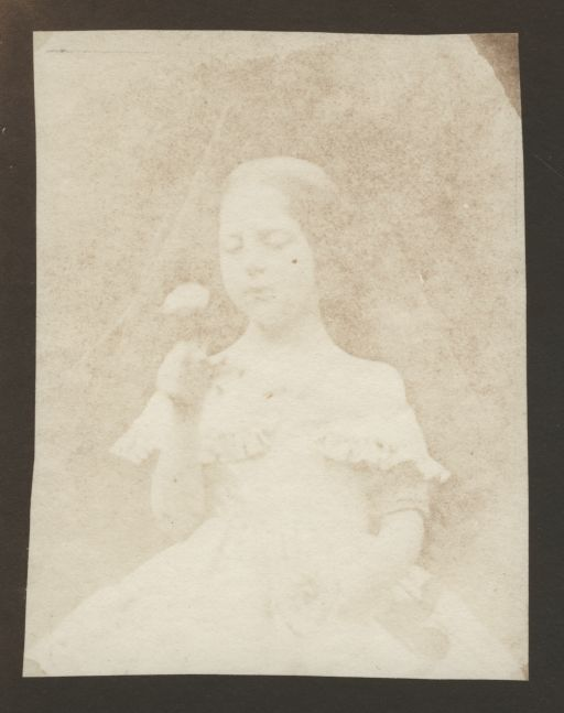 William Henry Fox TALBOT (English, 1800-1877) Portrait of Ela Theresa Talbot, contemplating a rose, circa 1843-1844 Salt print from a calotype negative 8.9 x 6.8 cm on 11.7 x 9.3 cm paper