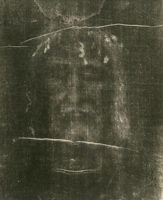 "Giuseppe ENRIE (Italian, 1886-1961) Detail of the Shroud of Turin, 1931 Gelatin silver print from a glass negative 29.5 x 23.4 cm mounted on 41.9 x 31.5 cm paper, ruled Blindstamped ""FOT. CAV. G. ENRIE / RIPRODUZIONE INTERDETTA"". Printed ""SANTO VOLTO DEL DIVIN REDENTORE / (PARTICOLARE DELLA S. SINDONE) / CAV. G. ENRIE FOTOGRAFÒ / RIPRODUZIONE INTERDETTA / ADORAMUS TE, CHRISTE, ET BENEDICIMUS TIBI / IL PRESIDENTE DELLA COMMISSIONE ESECUTIVA / TORINO 3 – 24 MAGGIO 1931"" on mount with ecclesiastical authentication in facsimile signatures. Luigi Gay Caroleria label on mount verso."