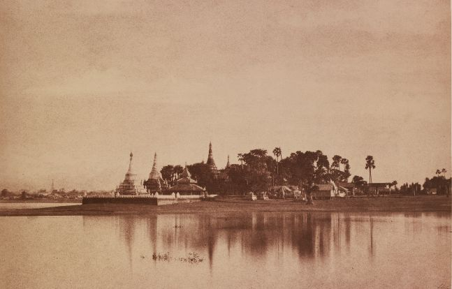 "Captain Linnaeus TRIPE (English, 1822-1902) ""No. 56. Amerapoora. View on the Lake."", September-October 1855 Albumenized salt print from a waxed paper negative 22.4 x 34.8 cm mounted on 45.6 x 58.3 cm paper Signed ""L. Tripe"" in ink. Photographer's blindstamp and printed label with plate number, title and ""Taken from the causeway crossing the Toung-deman lake at its Eastern extremity. A glimpse of the city is caught on the left."" on mount."