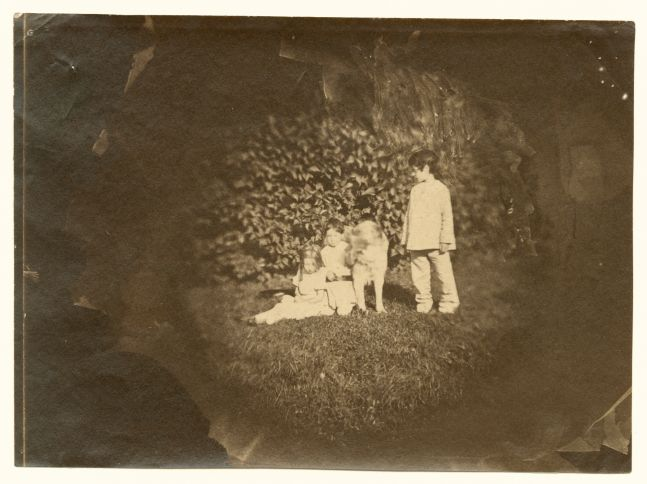 Charles NÈGRE (French, 1820-1880) The children of actress Rachel with a young girl and dog, Auteuil, probably autumn 1853 Albumen print from a collodion negative 9.7 cm tondo on 12.4 x 17.1 cm paper