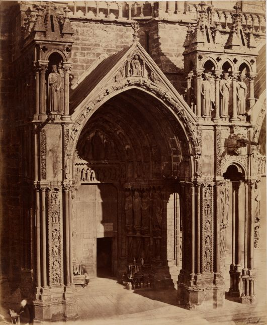 "Louis-Auguste & Auguste-Rosalie BISSON (BISSON FRÈRES) (French, 1814-1876 & 1826-1900) South porch, left portal, Chartres Cathedral, late 1850s Coated salt print from a glass negative 45.5 x 37.1 cm mounted on 59.7 x 46.1 cm paper Black ""Bisson frères"" signature stamp"