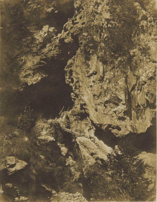 "Giacomo CANEVA (Italian, 1813-1865) Grotto of Neptune, Tivoli*, circa 1850 Salt print from a paper negative 21.0 x 16.3 cm Signed ""G Caneva"" in red crayon on verso"