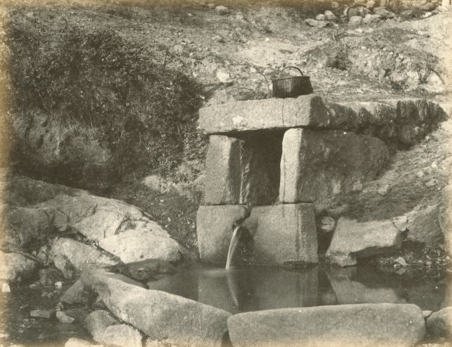 """Hugh OWEN (English, 1808-1897) Washing place with basket Albumen print, 1860s-1870s, from a paper negative, before 1855 17.4 x 22.2 cm mounted on 26.0 x 28.3 cm album sheet Numbered """"74"""" in pencil on mount"""