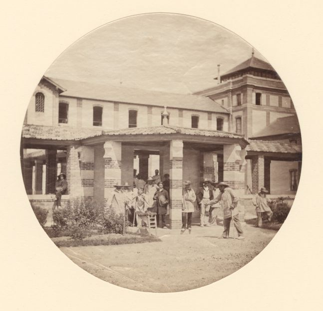 Charles NÈGRE (French, 1820-1880) Jouer aux boules, asylum, Vincennes, 1859 Albumen print from a collodion negative 16.7 cm tondo tipped onto 35.5 x 27.9 cm mat board