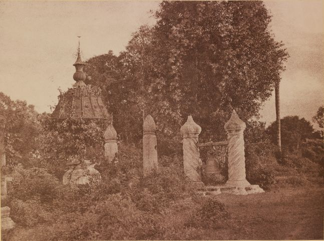 "Captain Linnaeus TRIPE (English, 1822-1902) ""No. 99. Mengoon. Small bell in front of Pagoda."", 1855 Albumenized salt print from a waxed paper negative 25.9 x 34.7 cm mounted on 45.6 x 58.3 cm paper Signed ""L. Tripe"" in ink. Photographer's blindstamp and printed label with plate number and title on mount."