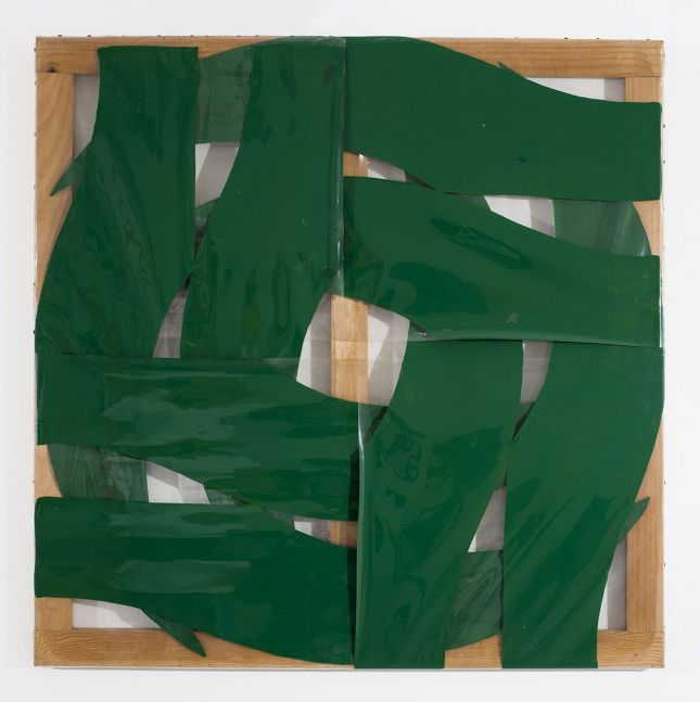 intersecting green swatches of color forming a circular pattern on transparent plastic stretched over a wood stretcher