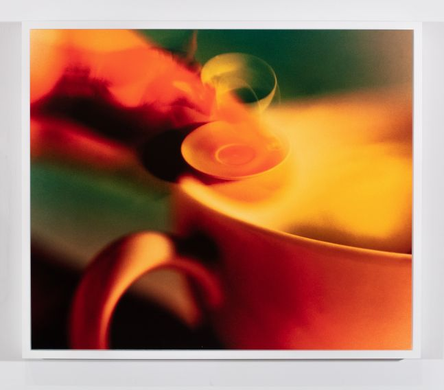 colorful photograph of a coffee cup being dropped superimposed over an image of another coffee cup