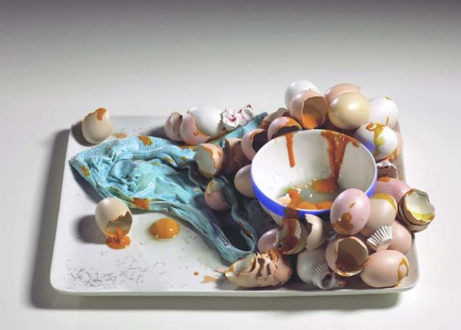 ceramic tray holding a bowl with broken eggs and eggshells