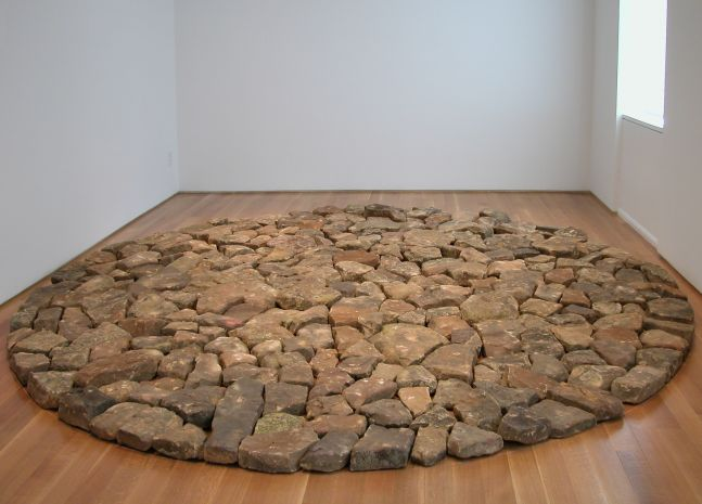 sandstone floor sculpture in the shape of a circle